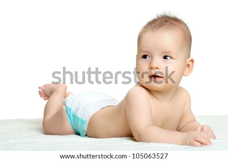the very  beautiful  little baby , lie on stomach,  on white background, isolated - stock photo