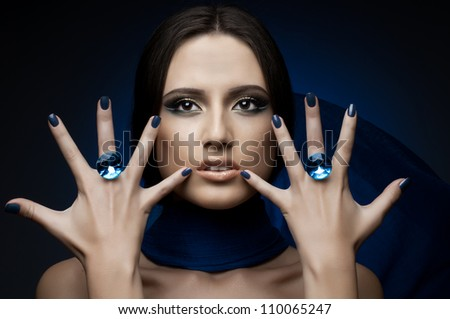 the very  pretty woman,  rings with huge blue brilliant, sensual sexuality gaze - stock photo
