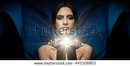 the very pretty woman with blue neckerchief and huge brilliant diamond - stock photo