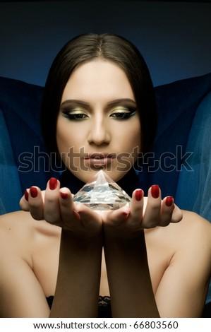 the very  pretty woman with dark blue neckerchief,  with huge brilliant, sensual sexuality gaze... - stock photo
