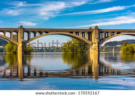 The Veterans Memorial Bridge reflecting in the Susquehanna River, in Wrightsville, Pennsylvania. - stock photo
