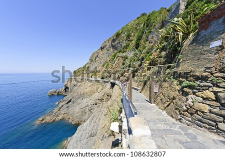 The Via dell'Amore in Riomaggiore, Italy  - La via dell'Amore or The Way of Love is a pedestrian street overlooking the sea linking the villages of Riomaggiore and Manarola, Cinque Terre, in Liguria. - stock photo