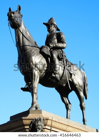 The Victorian bronze equestrian statue of the Duke of Wellington on his horse Copenhagen stands at Hyde Park Corner, London, England,UK. It was sculpted by Joseph Boehm and was unveiled in 1888 - stock photo