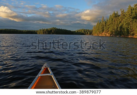 The view from a canoe, gliding on a lake in Algonquin Provincial Park, in Ontario, Canada.  - stock photo
