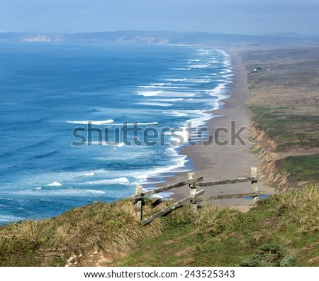 The view from behind the fence on the coast of the Pacific Ocean in the National Seashore Park Point Reyes. California, USA   - stock photo