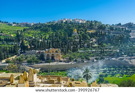 The view from the Muslim Cemetery on the slope of Mount of Olives with the Gethsemane Garden, Churches of All Nations, Mary Magdalene and Dominus Flevit, Jerusalem, Israel. - stock photo