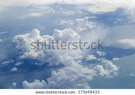 The view from the plane of cloud and blue sky - stock photo