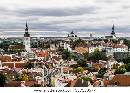 The view from the top of the Cathedral of St. Olaf  in old Tallinn at sunset. Estonia. - stock photo