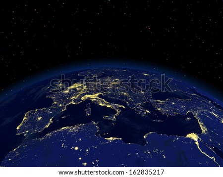 The view of a earth night side from space - stock photo