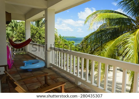 The view of a verandah of a beach house in the Caribbean - stock photo
