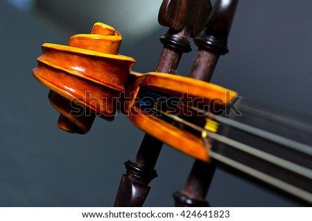 The view of a violin head on black background - stock photo