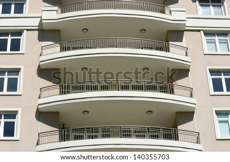 The view of curved balconies on a modern building - stock photo