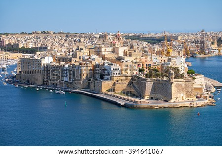 The view of Grand Harbour and Senglea (L-isla) peninsula  with  Fort Saint Michael on the tip from the bordering terrace of the Upper Barrakka Gardens. Malta  - stock photo
