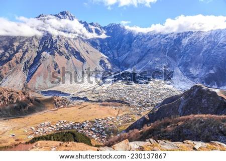 The view of Kazbegi Village from Tsminda Sameba Church, Georgia - stock photo