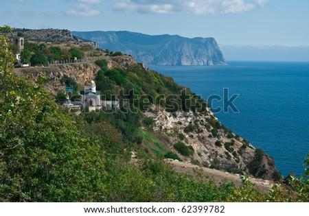 The view of sea coast in Sebastopol, Ukraine with the orthodox monastery on it - stock photo