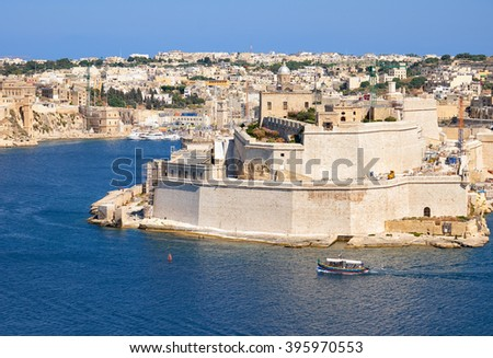 The view of the Grand harbor and Fort Saint Angelo on the seaward of Birgu from the bordering terrace of the Upper Barrakka Gardens. Malta  - stock photo