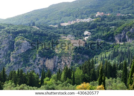 The view on mountains, cypress and olive trees in Corfu island, Greece - stock photo