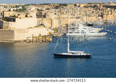 The view on Vittoriosa and yachts in sunset, Malta - stock photo