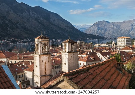 The view over the bay of Kotor, the two towers and the red roofs of the old town. Montenegro, the Balkan peninsula - stock photo