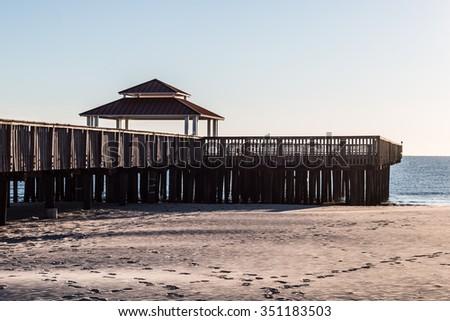 The viewing pier at Buckroe Beach in Hampton, Virginia. - stock photo