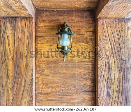 The vintage lantern decorated on the wall for interior design. It is made from glass and metal. - stock photo