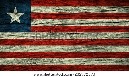 The vintage Liberian flag  on wooden surface - stock photo