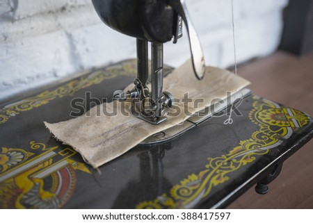 The vintage sewing machine  - stock photo