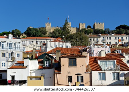 The visible profile of the Castle of Sao Jorge, a Moorish castle occupying a commanding hilltop overlooking the historic centre of the Portuguese city of Lisbona and Tagus River - stock photo