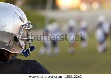 The vision of a football game from the bench - stock photo