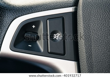 the volume control on the steering wheel of the car - stock photo