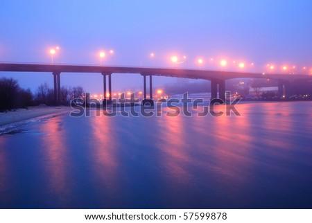The Voroshilovsky bridge. Rostov-on-Don. Winter. A fog. Night - stock photo