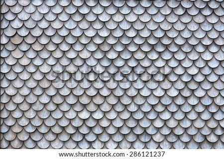 The wall covered with wooden shingles - wooden background horizontal. - stock photo