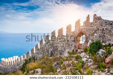 The wall of an ancient fortress on the hill in Alanya, Turkey. Beautiful summer landscape - stock photo