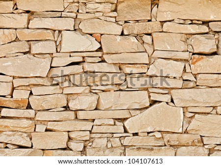 The wall of natural stone - natural background - stock photo