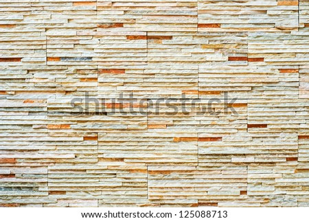 The walls are adorned with stones. - stock photo