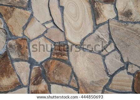 The walls are made of large rough stones - stock photo