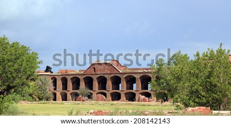 The walls of 19th century Fort Jefferson, as seen from the vast courtyard, are still impressive today. - stock photo