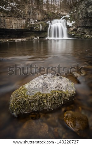 The water fall in the village of West Burton in the Yorkshire Dales Nation Park. - stock photo