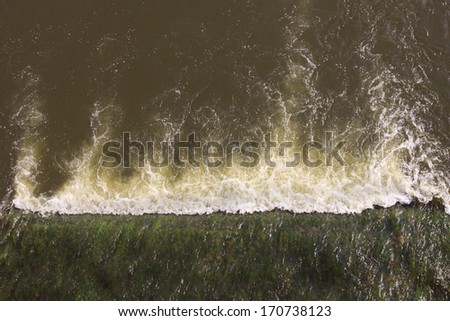 The water rushes ashore to make flood - stock photo