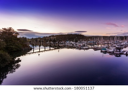 The waters in Friday Harbor's marina are still just after sunset. San Juan Islands, Washington - stock photo