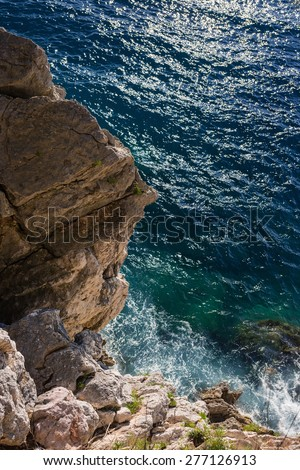 the waves lapping on the rocks - stock photo