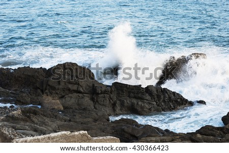 The waves of the Pacific ocean, the beach landscape. The ocean and waves during strong winds in United States, California. Waves breaking on the rocks. - stock photo
