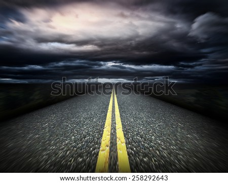 The way and dark clouds - stock photo