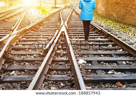 The way forward railway,beautiful girl walking on the railway - stock photo