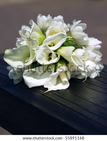 The wedding bouquet of the bride laying on shops - stock photo