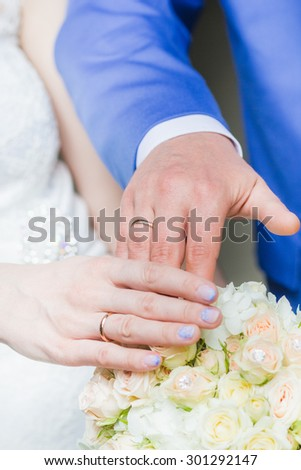 The wedding ceremony, the bride and groom hand Close-up, wedding rings, wedding bouquet - stock photo