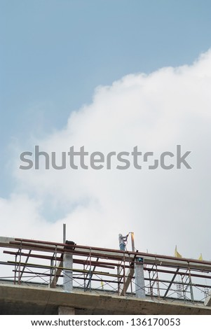 The welder  was working at a height level of the building - stock photo