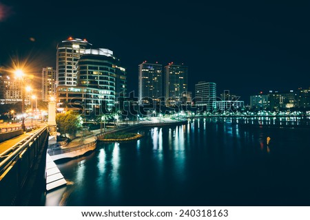 The West Palm Beach skyline seen from the Royal Palm Bridge at night, in West Palm Beach, Florida. - stock photo