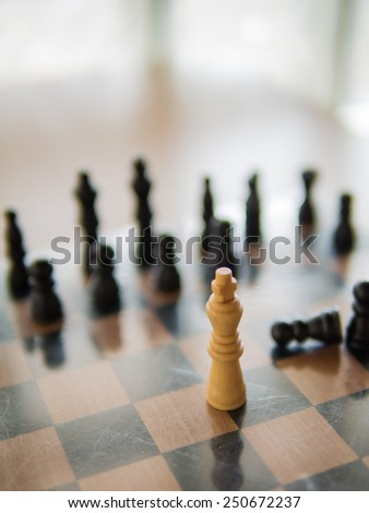 The white chess standing in front of black chess, Means Courage or resistance, Shallow in depth of field - stock photo