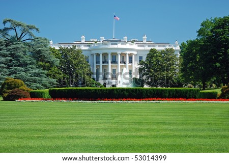 The White House in Washington DC with beautiful blue sky in background - stock photo